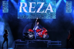 Reza appears on a motorcycle!